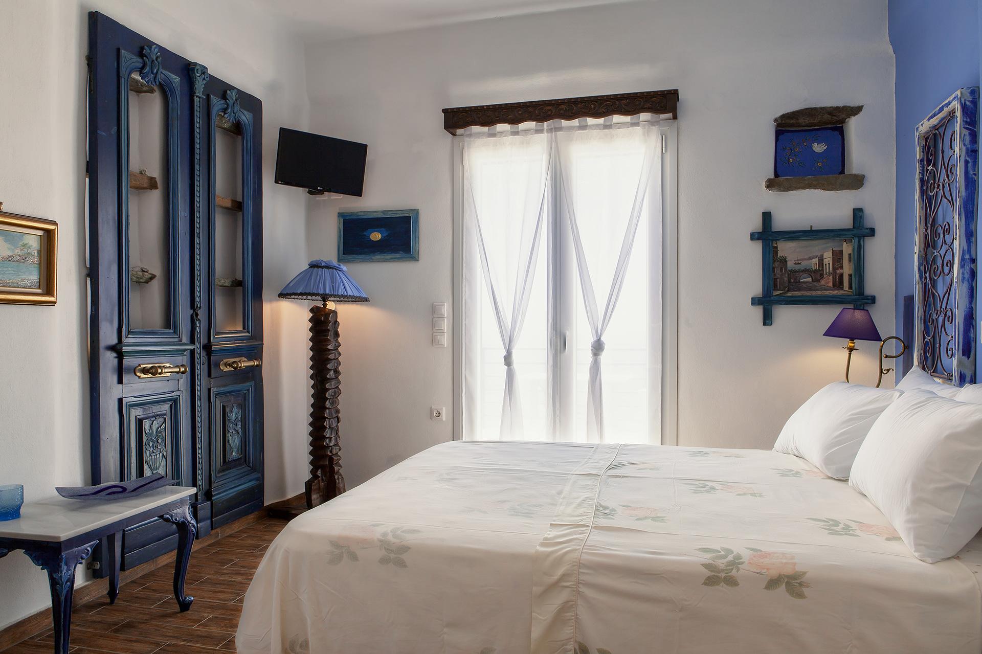 Castria studios blue bedroom king bed | castriastudios.com